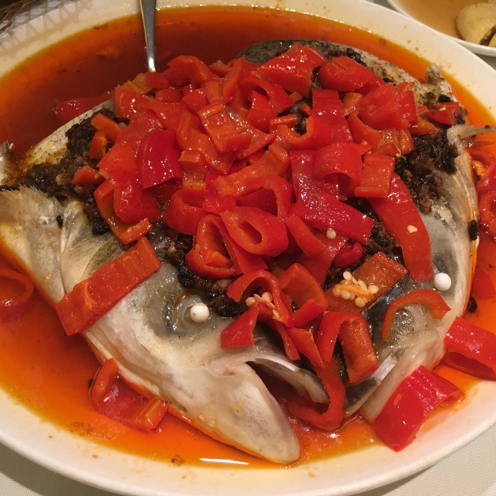 Steamed fish head laden with chilies at Liu Yuan Pavilion