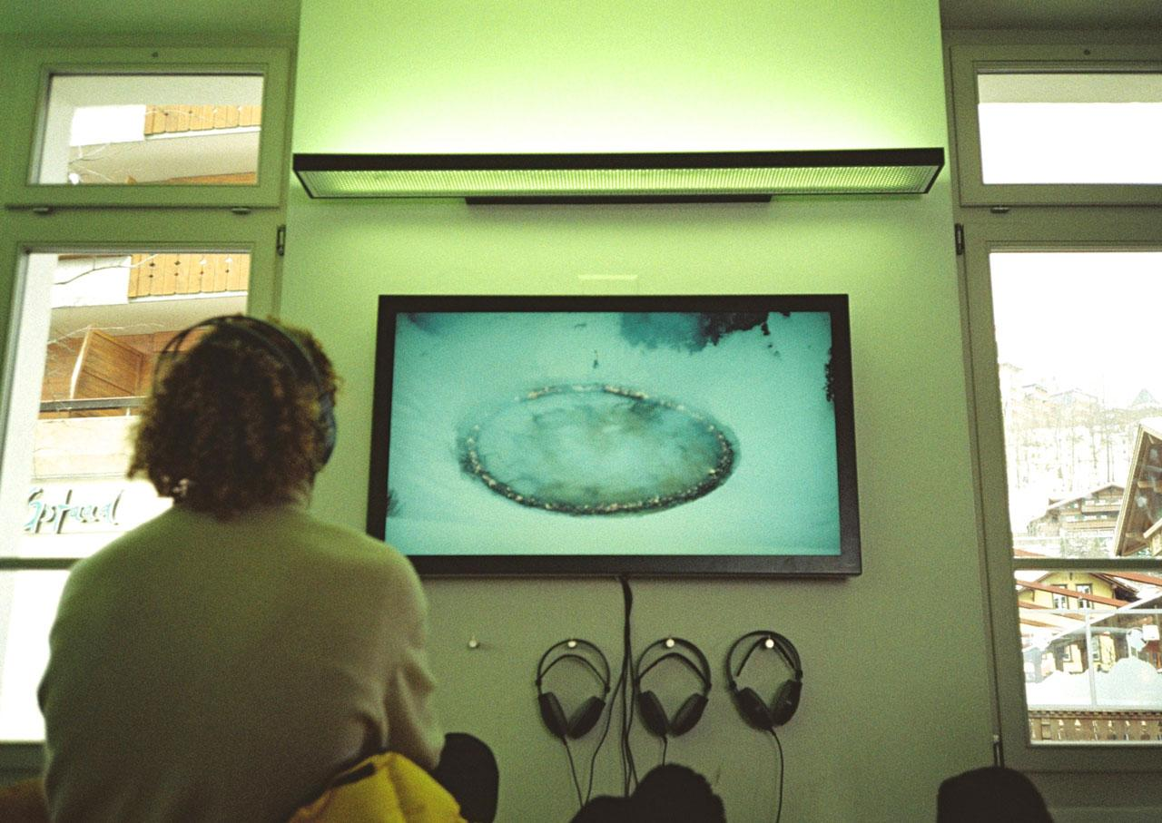 Douglas Gordon & Morgane Tschiember Video documentation of the performance /As close as you can for as long as it  lasts/ (2017) on view in Gstaad railway station waiting room
