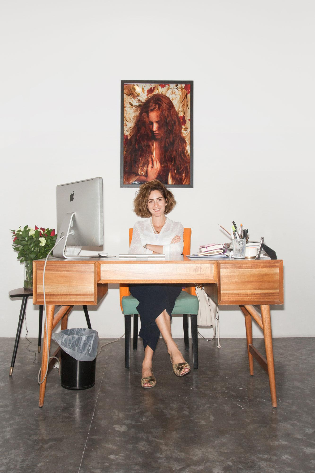 Yasmin Atassi, director of Green Art Gallery /A Pre-Raphaelite picture /byNazif Topçuoglu in the background