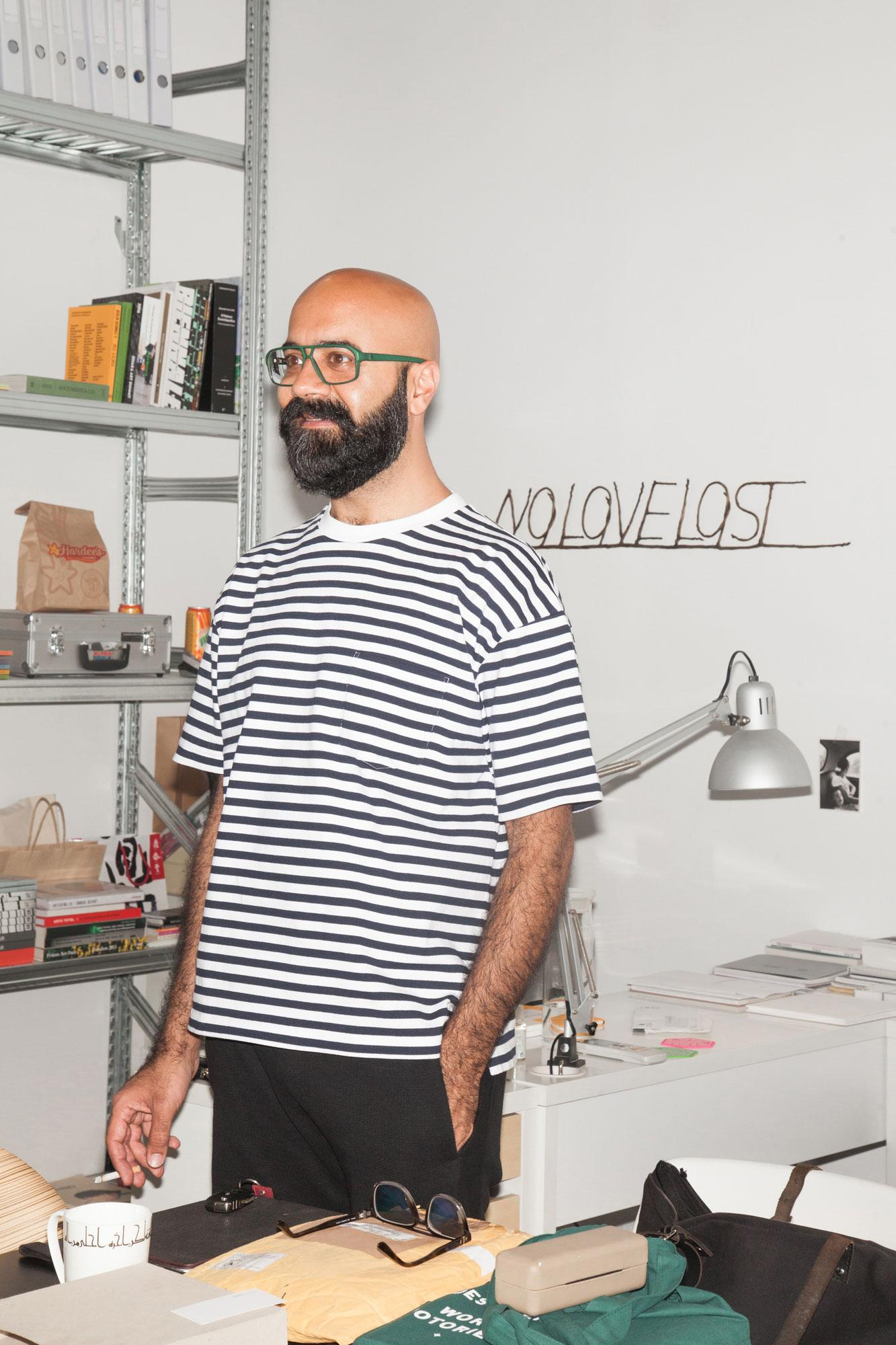 Umer Butt, founder anddirector ofGrey Noise gallery  /No Love Lost /byHossein Valamanesh in the background