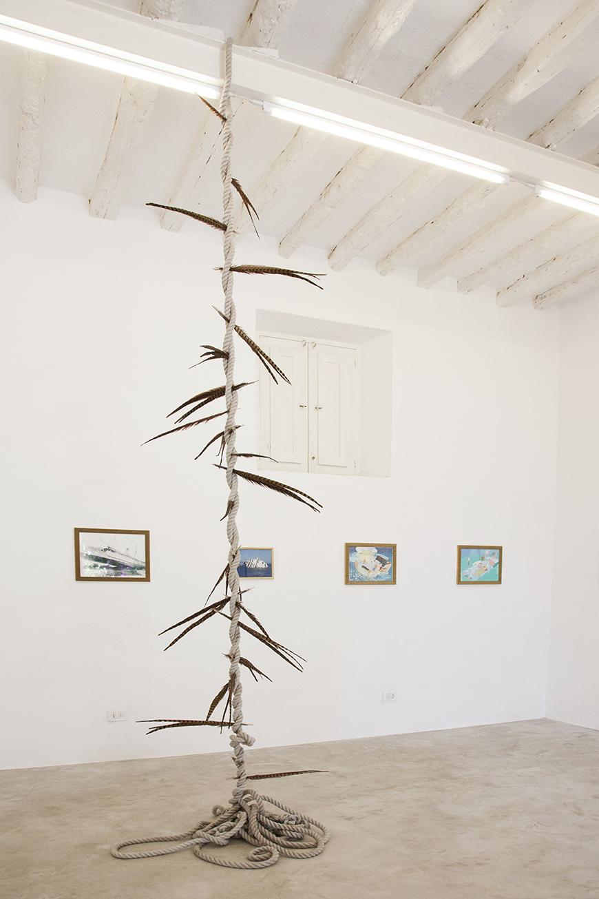 """In the front: Maria Loboda, /Witch's Ladder/, 2014 Sisal rope, Lady Amherst pheasant feathers Installation view """"I Will Go Where I Don't Belong"""" © Courtesy of the artist and Maisterravalbuena, Madrid.Photo:Giovanna  Silva. Courtesy Fiorucci Art Trust, London"""