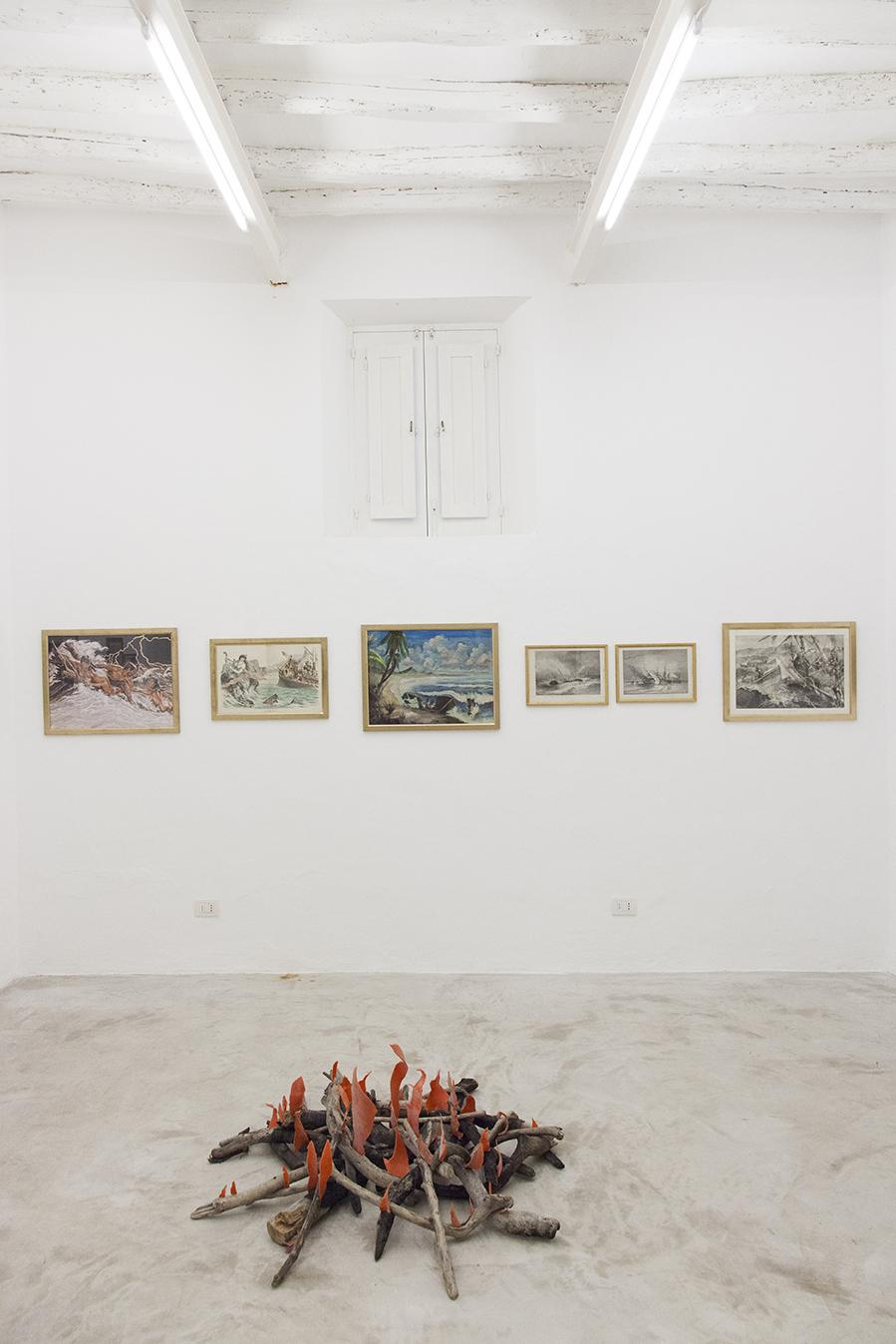 """Installation view """"I Will Go Where I Don't Belong"""" On the back: Works from the Henrot Family Collection In the front: Mike Nelson,/Diyagram (Amnesiac beach fire)/, 2015 Wood and plastic © Mike Nelson, courtesy 303 Gallery, New York  Photo:Giovanna Silva. Courtesy Fiorucci Art Trust, London"""