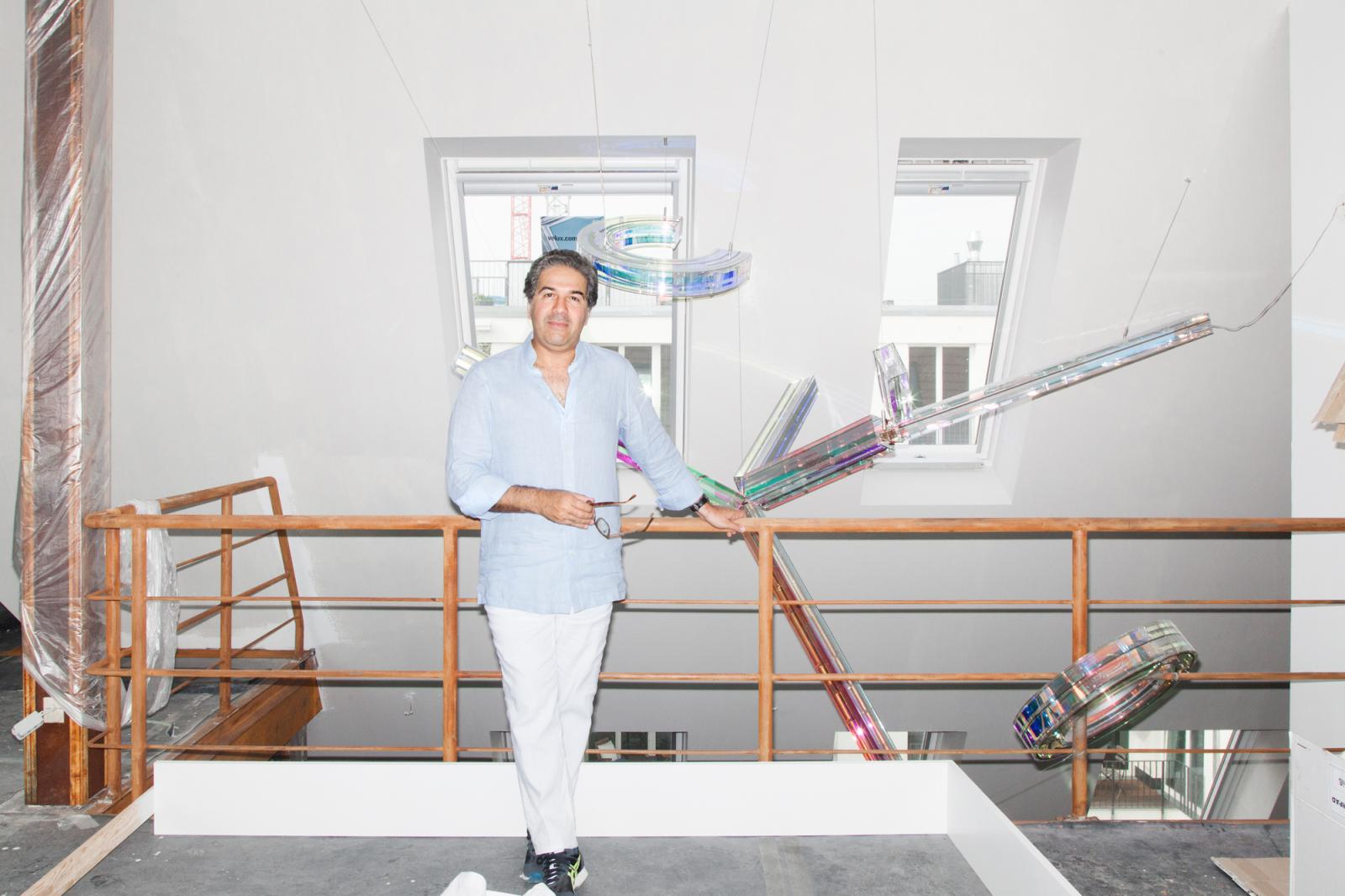 Ramin Salsali, founder & director of the Salsali Private Museum at his flat  in Berlin Background: /Scala Salsali/ by Susanne Rottenbacher