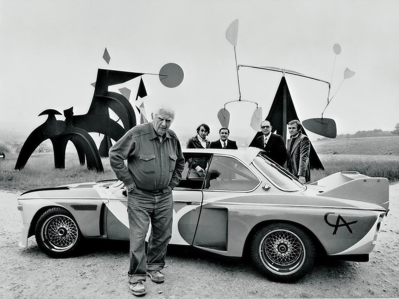 Alexander Calder in front of his BMW Art Car