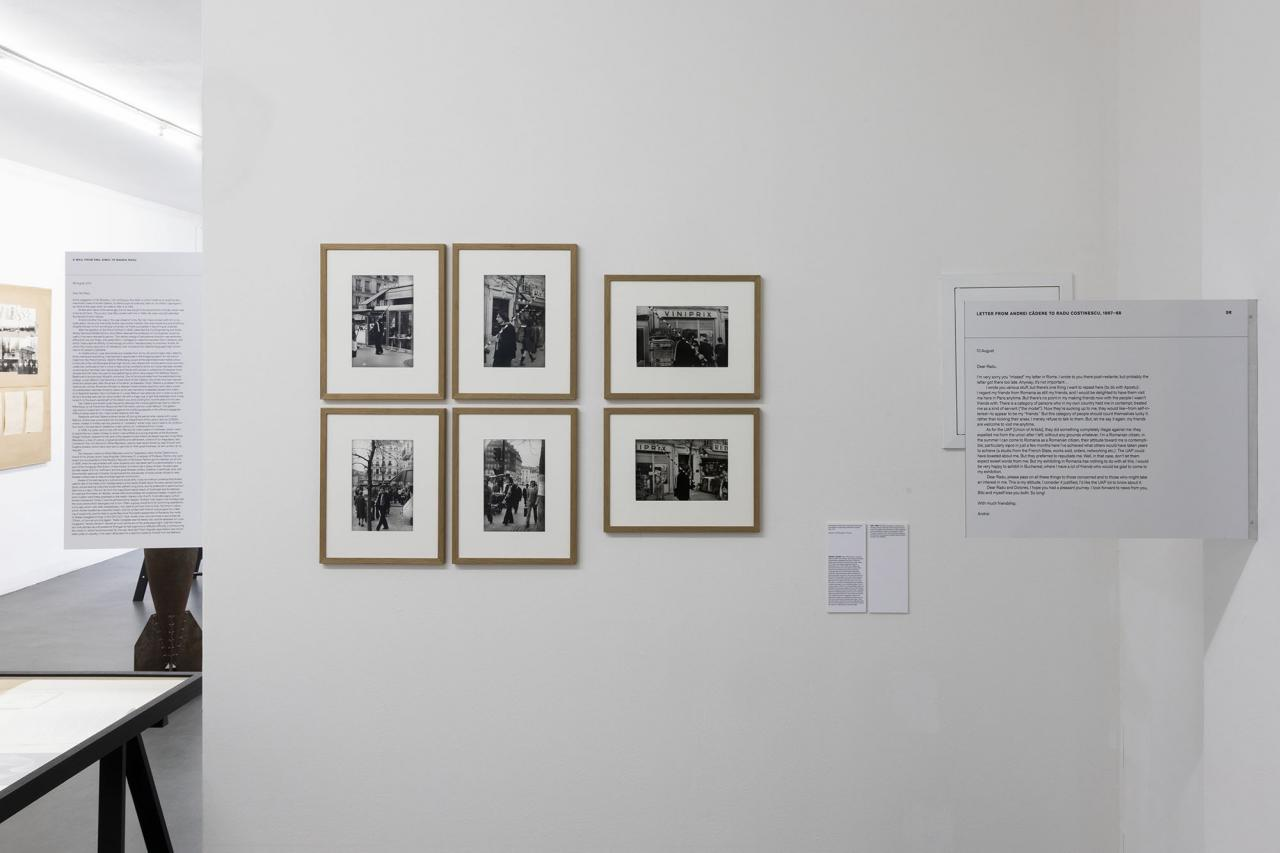 Installation view including photographs of André Cadere during a promenade with the wooden bar, organized by Galerie des Locataires, Paris, 1972