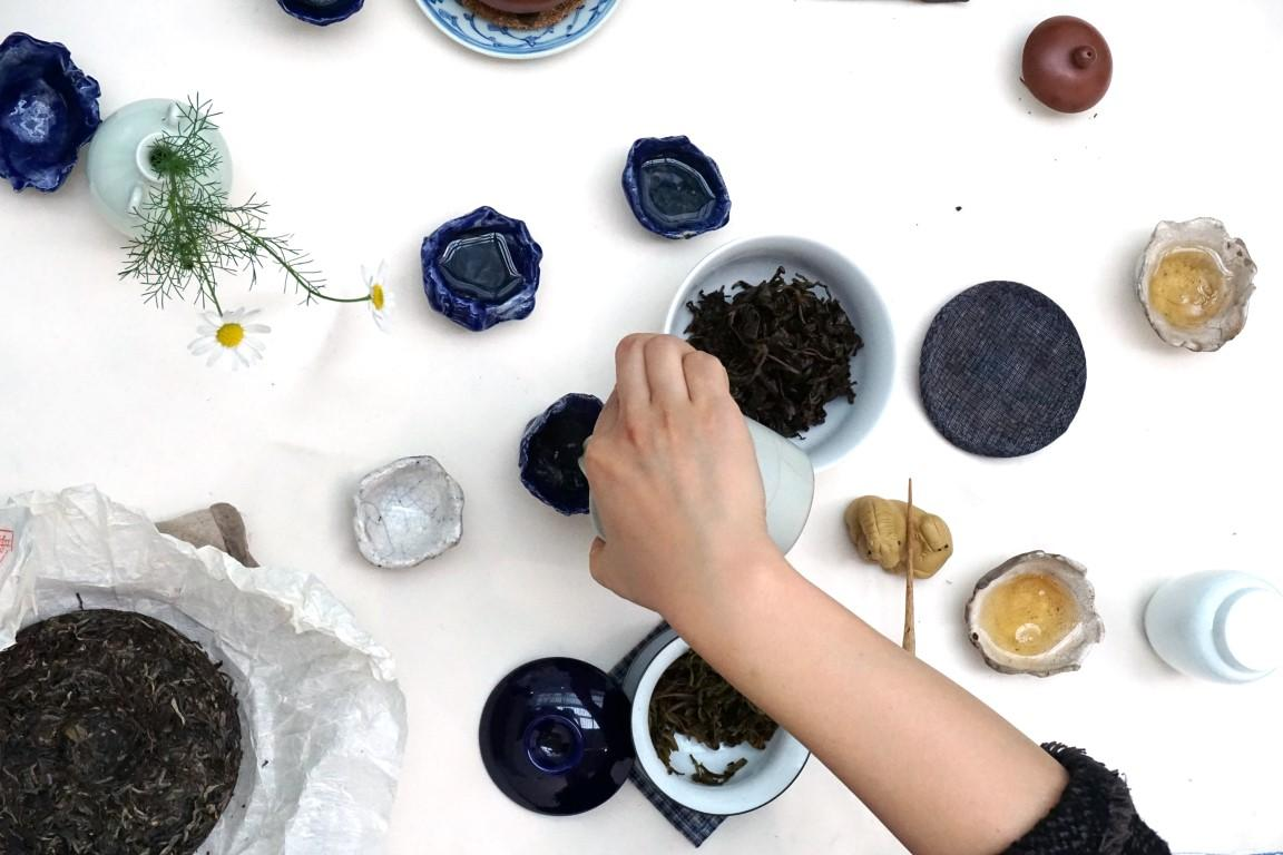 Ying-Leserving special handcrafted tea in Raku ceramic tea cups made by Reto Pulverduring a performance inside Reto Pulver's installation at Fiac, Paris, 2015. Photo: Reto Pulver