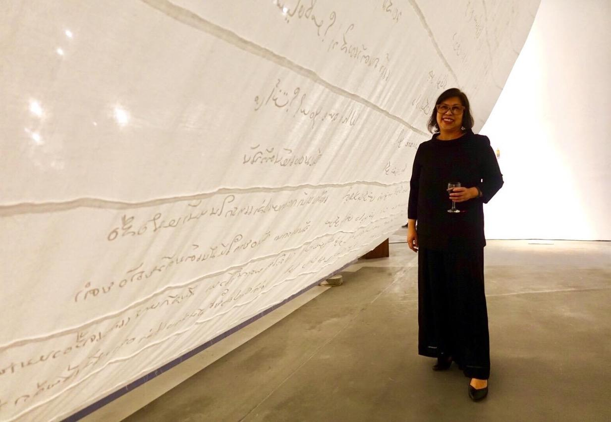 "Gaweewong next to Zakariya Amataya's work at the opening of ""Patani Semasa"" at ILHAM in Kuala Lumpur, Malaysia"