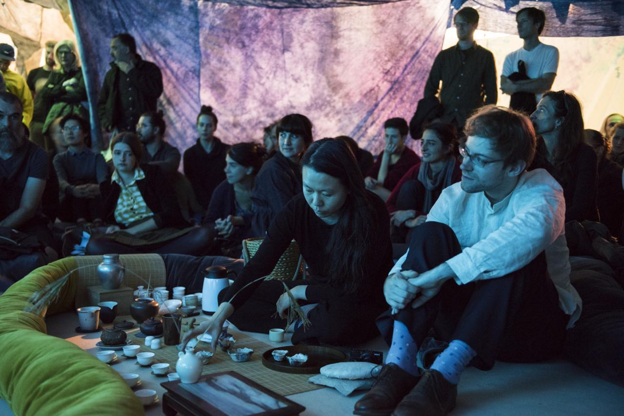 Ying Le and Paul Sochacki serving tea inside Reto Pulver's installation Dehydrated Landscape of a Condition (2007–2015) at Haus Der Kulturen der Welt, 2015 © Sebastian Bolesch for HKW