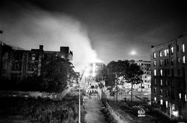 """Ken Schles Burning Building with Moonrise, East 4th Street (1984) from the series """"Invisible City"""""""