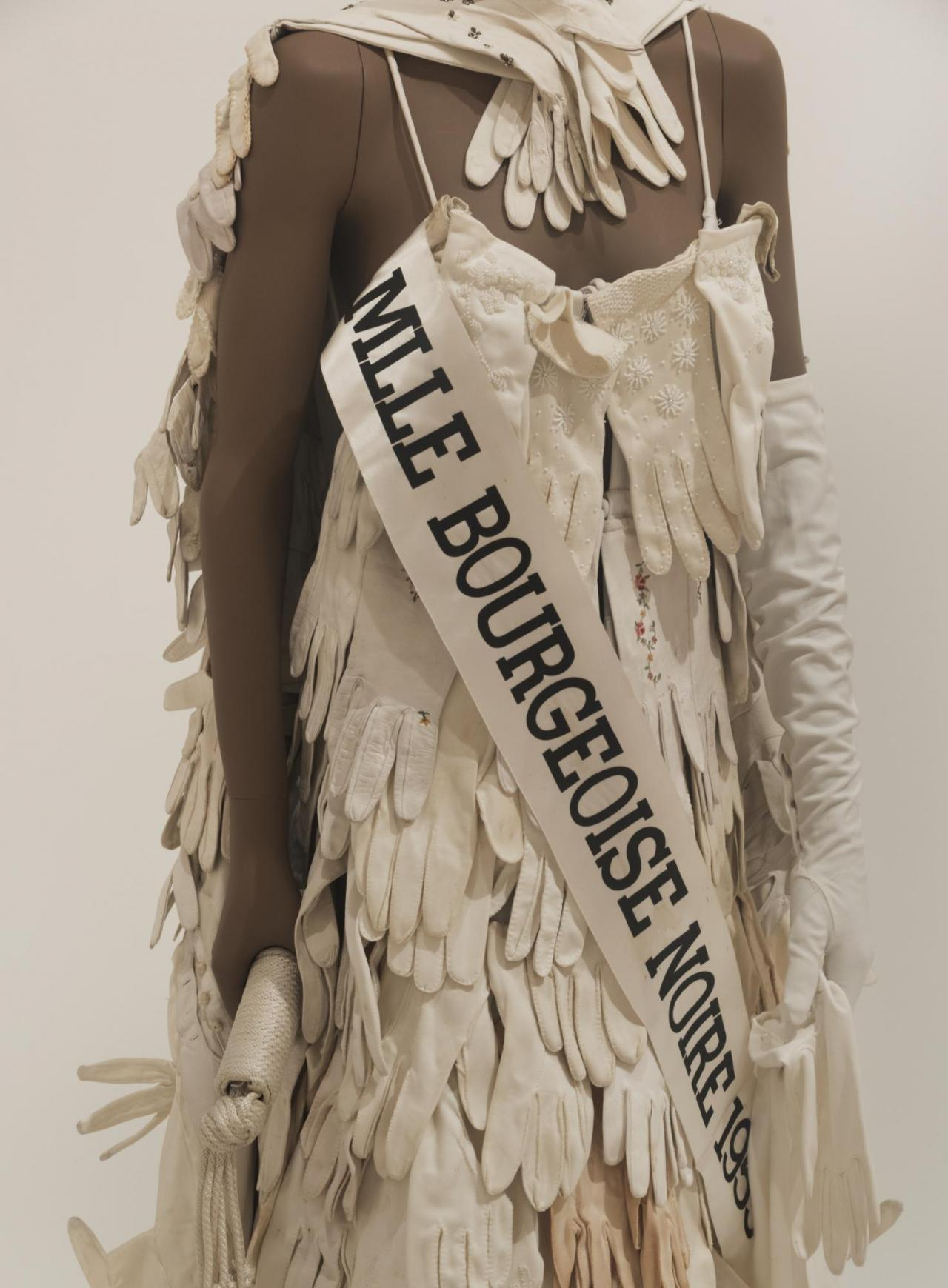 Lorraine O'Grady, Mlle Bourgeoise Noire Costume , 1980, Costume made from white gloves, shoes, tiara, sash, pair of gloves, 176× 55× 71cm,