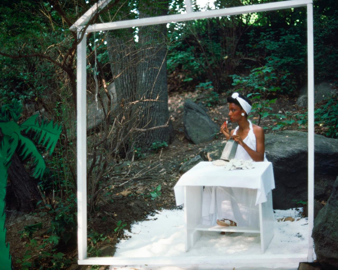 Lorraine O'Grady, Rivers, First Draft: The Woman in White eats coconut and looks away from the action , 1982/2015, digital chromogenic print from Kodachrome 35mm slides in 48 parts, 40× 50cm. Edition of 8 + 2 AP. Courtesy Alexander Gray Associates, New York. © Lorraine O'Grady/Artists Rights Society (ARS), New York