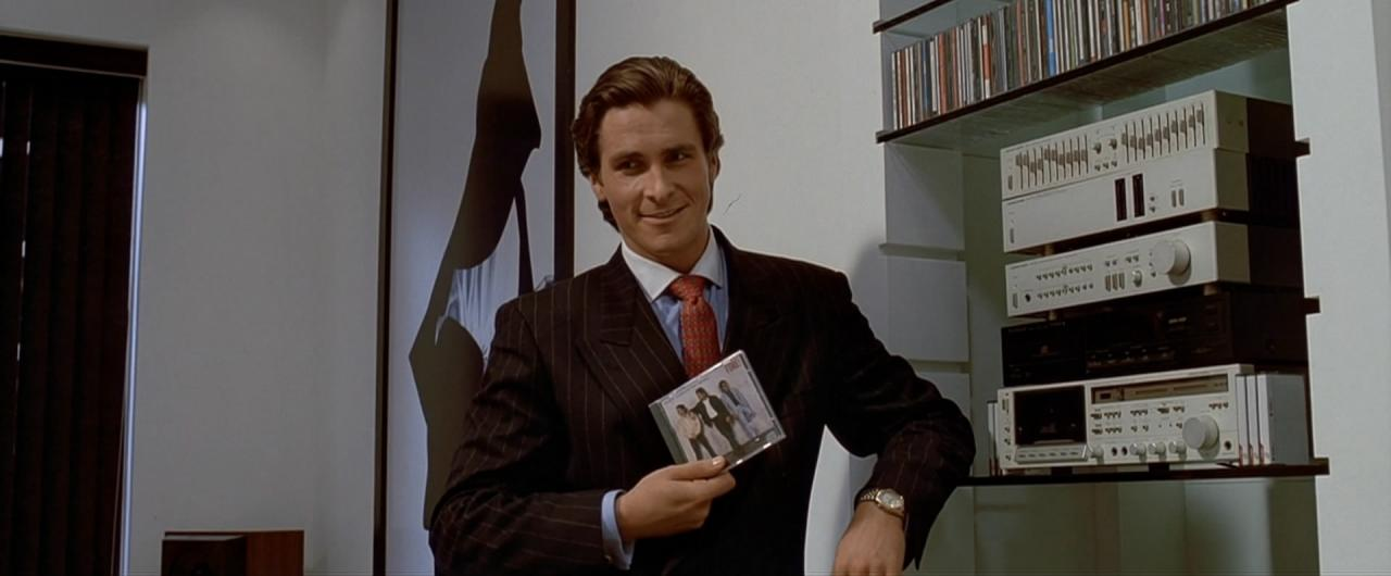 Still from American Psycho, 2000 Christian Bale as Patrick Bateman with Huey Lewis and The New's album Fore!