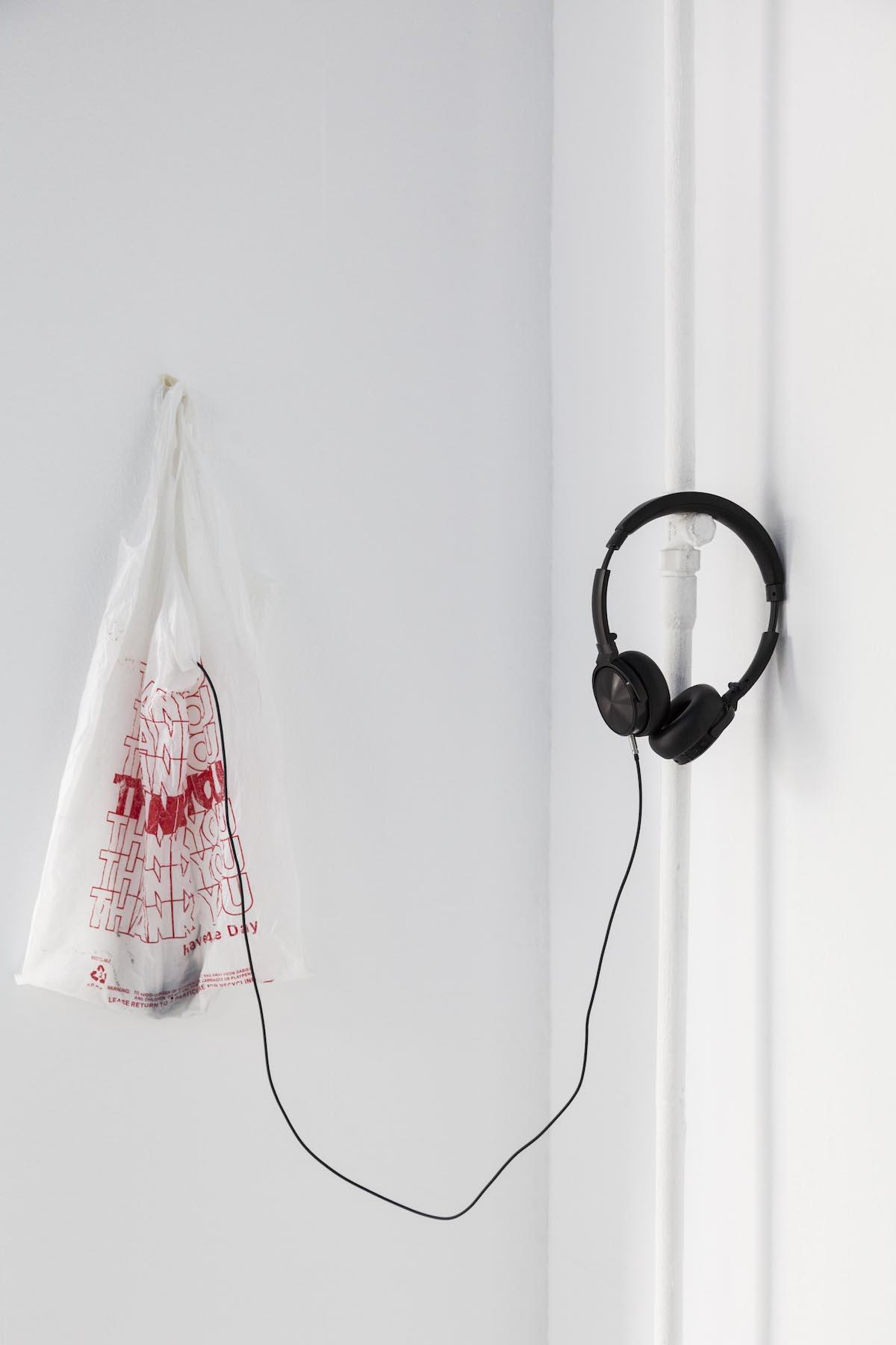 "Noele Ody Thank You, Fuck You, 2012, Plastic bag ""Thank You"", Mp3 player with looped song, headphones"