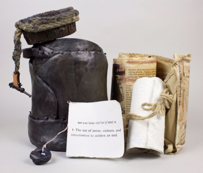 """CBA Collections Item""""Terrorism"""" by Edna Lazaron (1985). Mixed media sculptural work. Number 4 in an edition of 6. Signed and dated by the artist."""