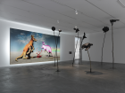 """View of """"DOGGO"""" Background: Judgement. The kangaroo is not happy. it's not clear who or what it represents but it's not in a good place (2014) Backlit digital print on vinyl, 400 x 786 cm Photo: Annik Wetter"""