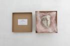 Nina Beier Crybaby , 2019 Foot scrub pumice stone, faux gemstone earrings